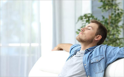 Man in a denim jacket relaxing on the couch