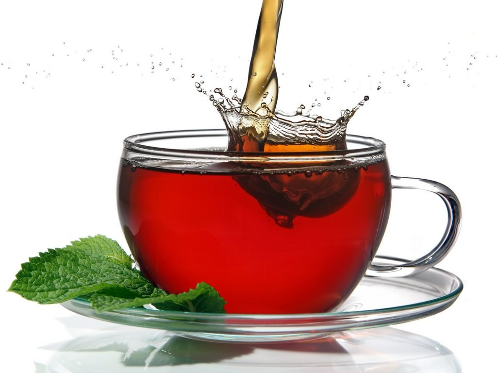Red tea with mint leaves
